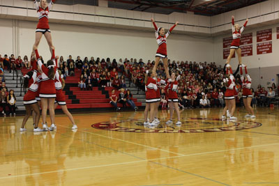 Cheerleaders are going to show new members how to build pyramid. Photo By; Danielle Jackson