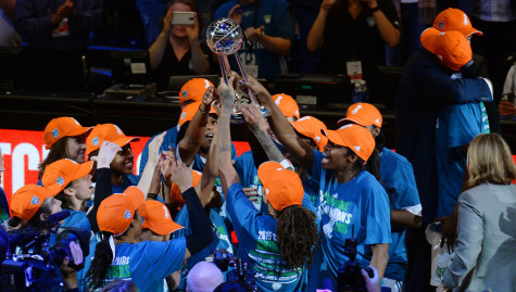 The Minnesota Lynx celebrate their 2015 WNBA Championship photo by: John Autey