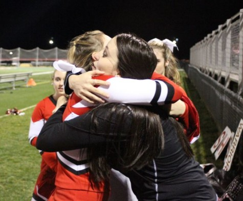 Senior Kayla Bennett hugs Coach Beste after receiving her personalized jersey. Photo by Karly Matthews.