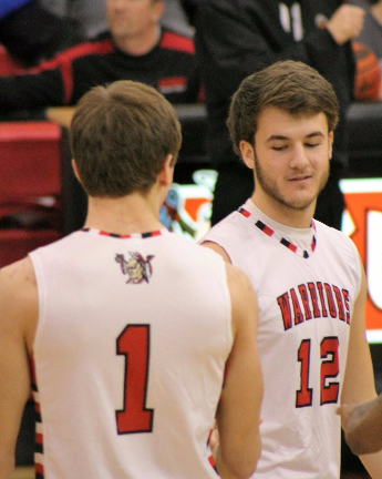 Seniors Nick Tannura (left) and Josh Stoneberg (right) before tip-off on Saturday night. Photo by Ally Kerr.