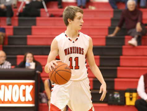 Junior guard Adam Hedgeland looks to pass during a game. Photo by Mike Inkrote.