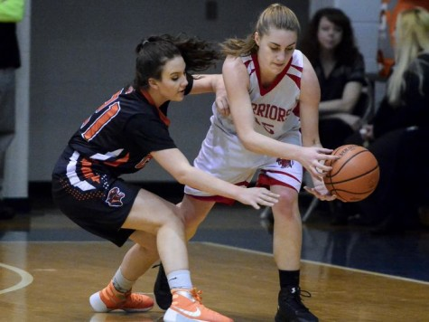 Anna Mahan trying to grab the ball. Photo By; York Dispatch