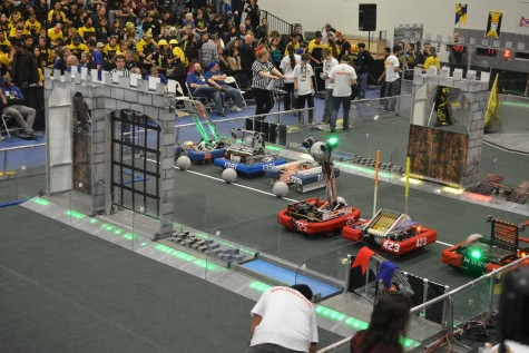 The team's robot rests on the field, waiting for the match to start. Photo courtesy TechFire 225.