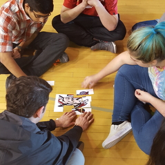 Students work together to solve a puzzle in their small groups.
