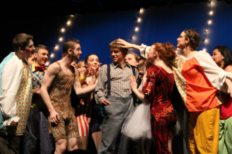 "Cast members from the latest musical, ""Pippin,"" gather around Pippin himself (Julian Sherman, center) after he sings his first solo."