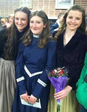 "(From left to right) Brooke Weber, Megan Barnish, and Elizabeth Martin, now seniors, pose after a performance of their freshman show, ""Phantom of the Opera,"" the first theater experience for each of them."