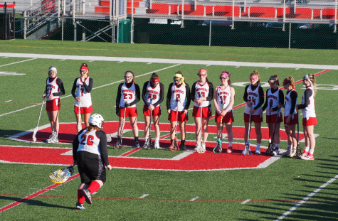 The team lines up before the game. Photo by Lisa Miller.