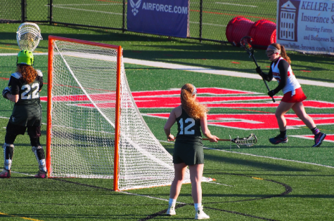 York Catholic defends their goal. Photo by Lisa Miller.