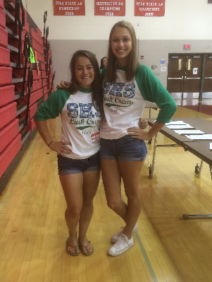 Senior Link Crew leaders Maddy Mummert (Left) and Ashley Cox (Right) stand beside each other on orientation day for the freshmen in August. Photo by