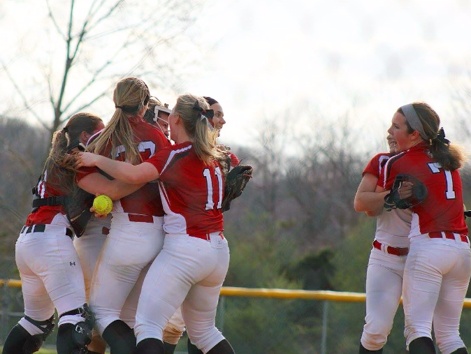 Some+members+of+the+girls+softball+team+celebrate+after+their+rivalry+win+against+Dallastown.+Photo+by+Lori+Staub.