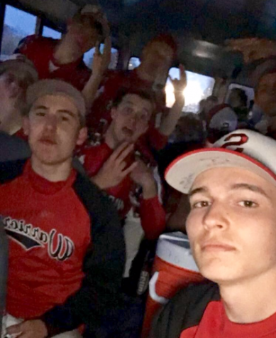 The baseball team selfies on a bus ride home after a team win. Photo by Logan Mohar.