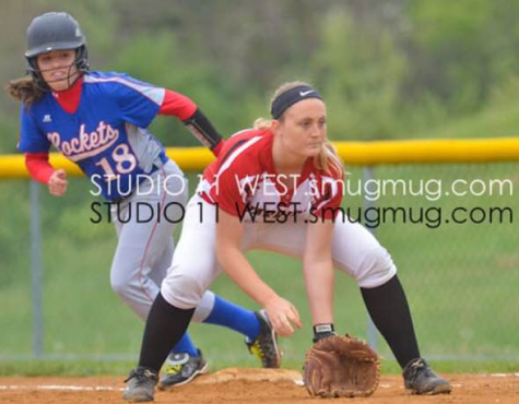 Ally Kerr gets into defensive position at first base. Photo By: Studio West Photography