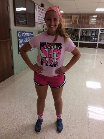 Senior Casey Kummer is showing her support by wearing the Dig pink shirt