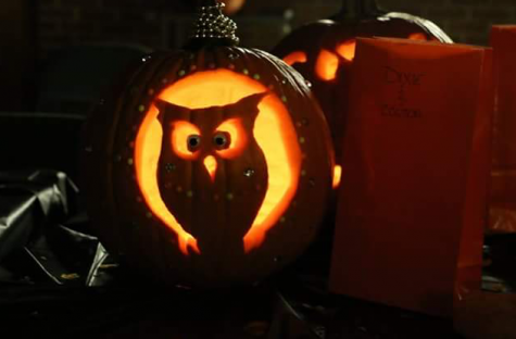 Some people get creative with their pumpkin carving designs, such as this owl design.