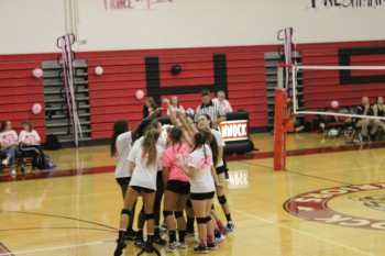 Varsity Volleyball Wins Dig Pink Game