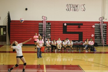 Allie Grothey spiking the ball.