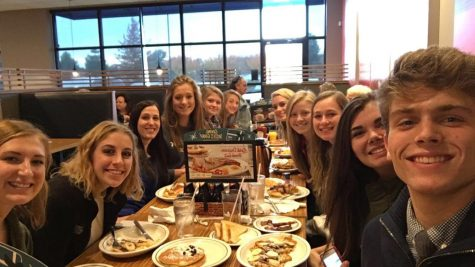 The staff poses for a selfie while bonding at IHOP. Photo Courtesy: Chase Summers
