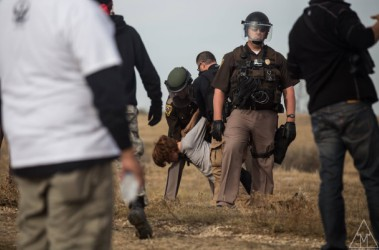 An activist getting arrested during the protests in South Dakota.