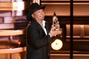 Garth Brooks with his Country Music Award. (Photo by Charles Sykes/Invision/AP)