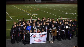 The marching band + color guard posing after the big win