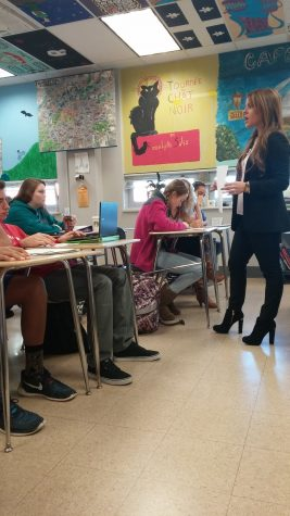 Vaira instructs her students on what they need to do for the remainder of class. Photo by: Ariel Barbera