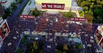 """A screenshot from """"We The People"""" music video."""