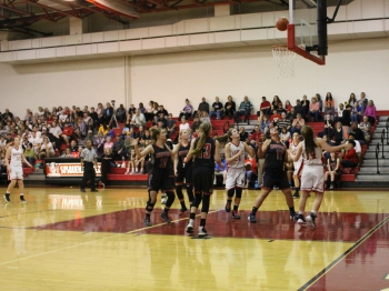 The Lady Warriors battle with Dover for rebounds under the basket.