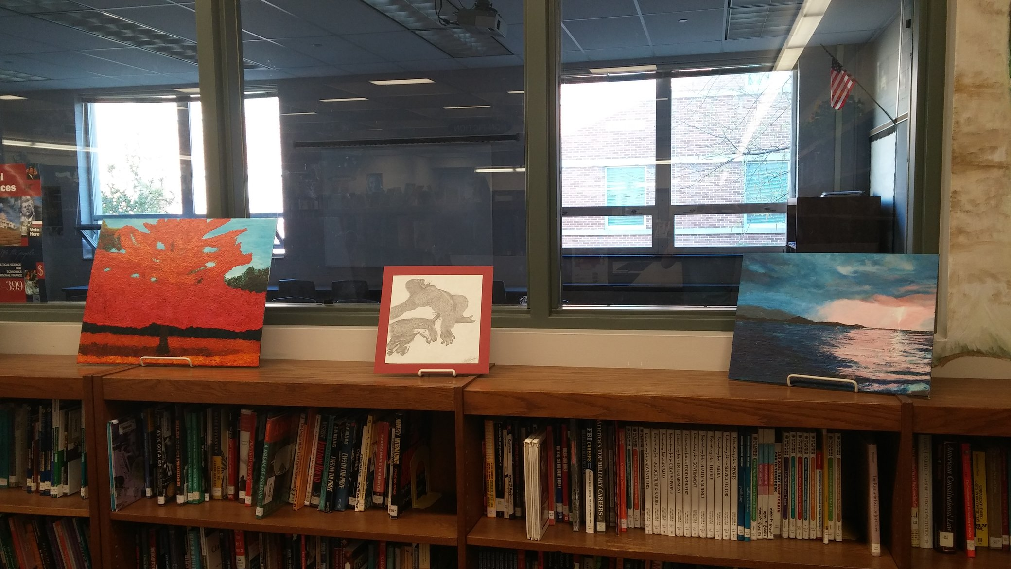 The library is currently displaying a variety of different pieces from the  art students. Photo by: Ariel Barbera