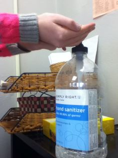 Student using handsantizer to prevent the spread of the flu