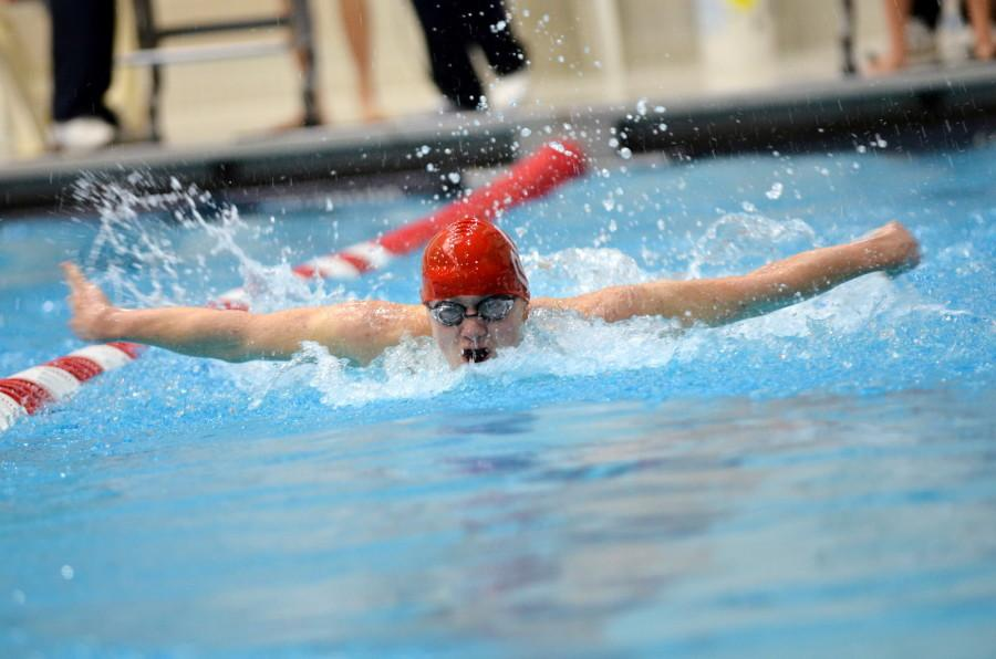 Sophomore Mark Freidhoff swims butterfly at districts.