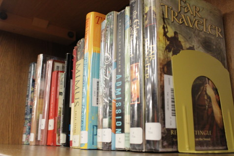 Library books are placed on shelves for the 2013-2014 school year.