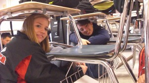 Students 'duck and cover' for the earthquake drill
