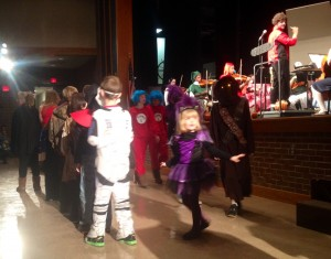 The high school orchestra serenaded children participating in a costume contest.