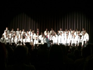 """The combined men's choir joined together to sing """"Rest Not"""" by L. Farnell. Photo by: Maddie Kroner"""