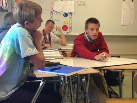 Junior Gibson Porter and senior Zach Orner work on whiteboard problems in AP Calculus AB.