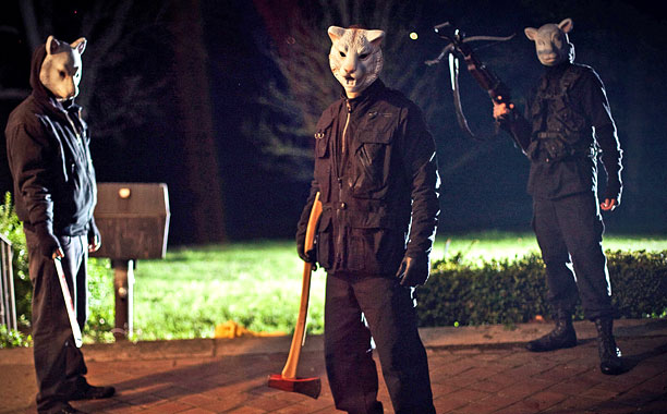 The masked killers in You're Next stalk their victims. Still courtesy Lionsgate.
