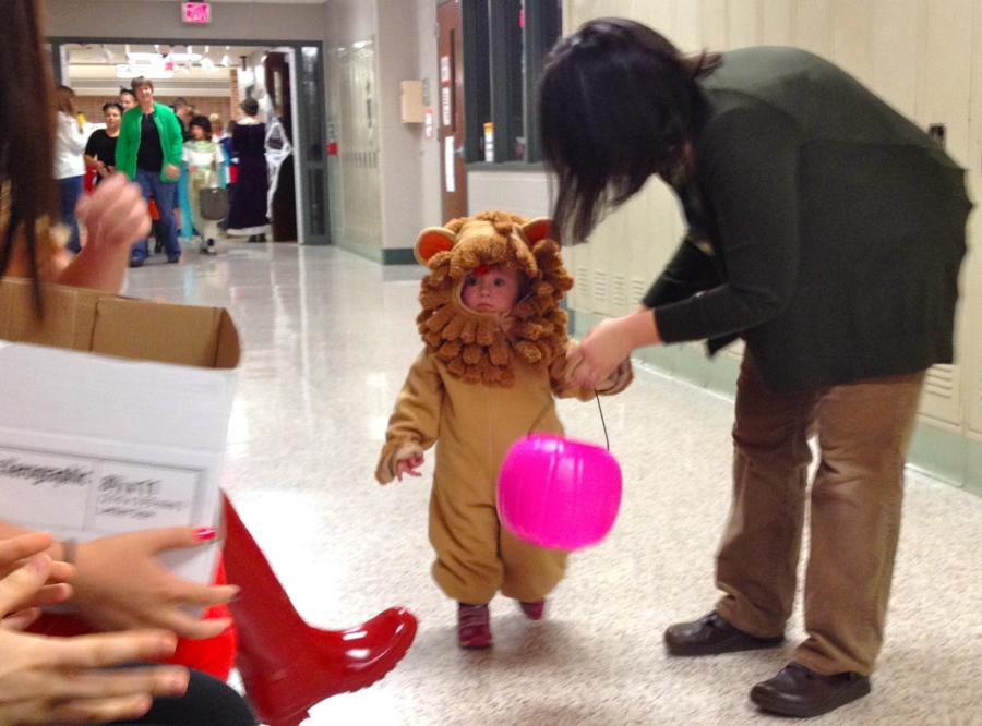 Math teacher Kori Eisenhart and her daughter trick-or-treat in the halls of the school.