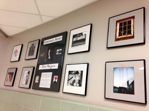 Pergrin put together a display of his work, which hangs by the library.  Photo By: Grace Burns