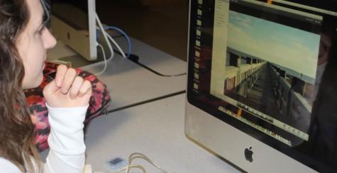 Bortner works hard while editing her photos.