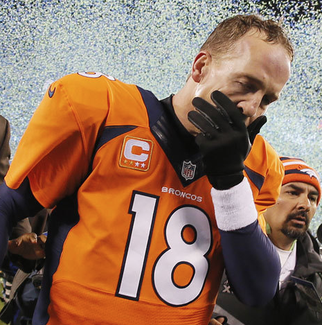 Peyton Manning follow his Super Bowl 48 loss. Photo by Kevin Cox