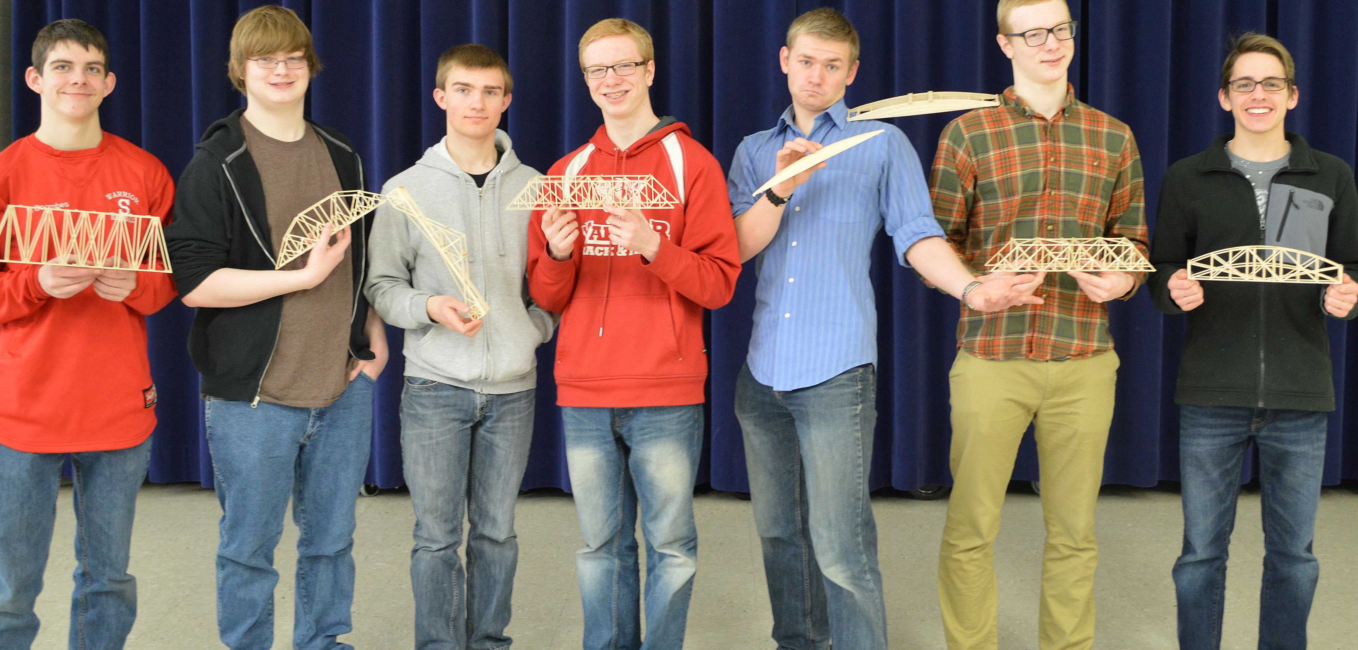 Students in the competition posing with their bridges.