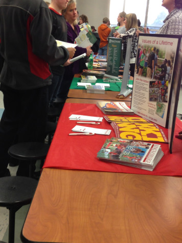 Fliers and brochures were offered to students and parents browsing the institutions.  Photo By: Grace Burns