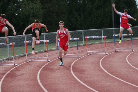 The boys team competes in 300m hurdles.