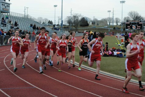 Both the girls and boys teams run in a distance competition.