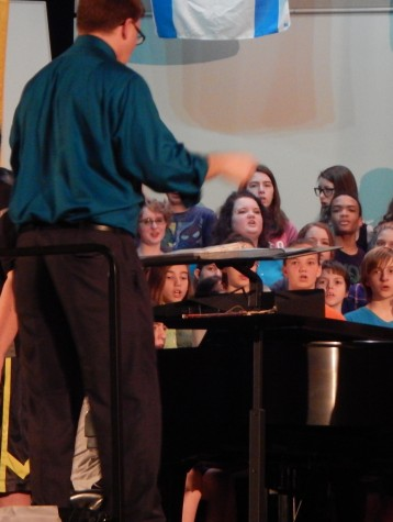 Jay Althouse is the conductor of the choir.