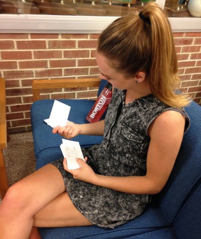 Larum studies flash cards at the NHS tables. Photo By: Grace Burns