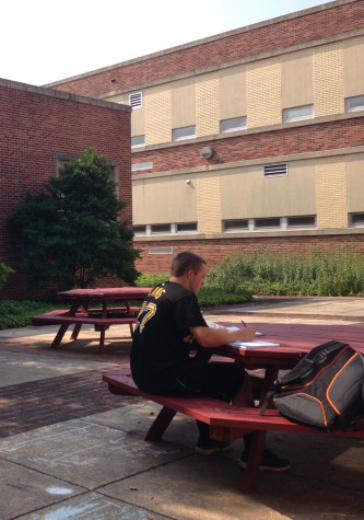 Senior Connor Hood studies at one of the round tables. Photo By: Grace Burns