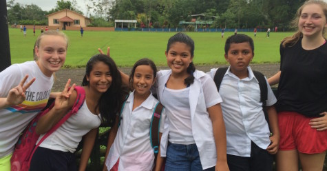 Students pose with children from the local elementary school in La Fortuna, Costa Rica.