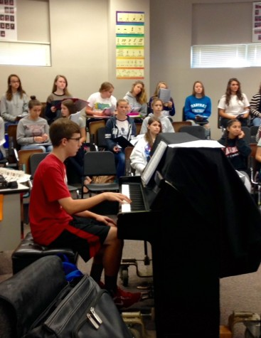 Sophomore Justin Feild accompanies the choir in a few of the songs.