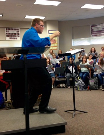Choir director Jay Althouse conducts the choir during Seussical the Musical